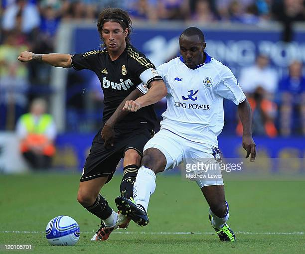 Sergio Ramos of Real Madrid and Darius Vassell of Leicester challenge for the ball during the PreSeason Friendly match between Leicester City and...