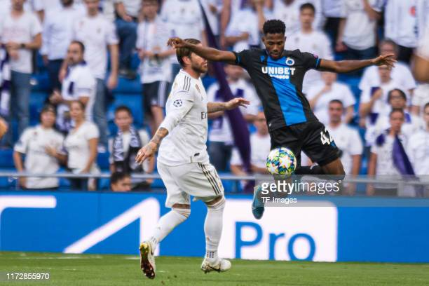 Sergio Ramos of Real Madrid and Emmanuel Bonaventure of Club Brugge battle for the ball during the UEFA Champions League group A match between Real...