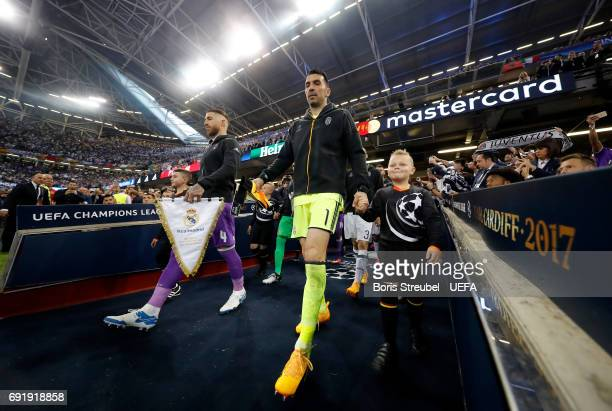 Sergio Ramos of Real Madrid and Gianluigi Buffon of Juventus lead their teams out prior to the UEFA Champions League Final between Juventus and Real...