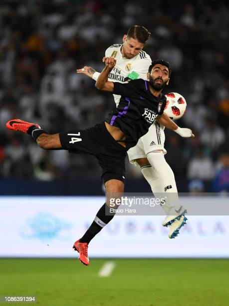 Sergio Ramos of Real Madrid and Hussein Elshahat of Al Ain compete for the ball during the FIFA Club World Cup UAE 2018 Final between Real Madrid and...
