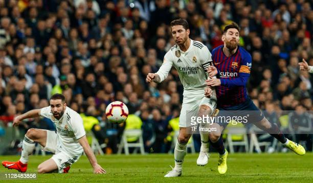 Sergio Ramos of Real Madrid and Lionel Messi of Barcelona battle for the ball during the La Liga match between Real Madrid CF and FC Barcelona at...