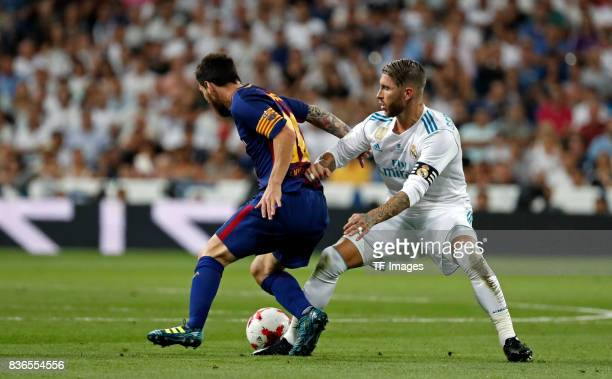 Sergio Ramos of Real Madrid and Lionel Messi of Barcelona battle for the ball during the Supercopa de Espana Supercopa Final 2nd Leg match between...