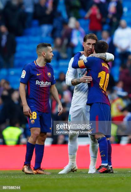 Sergio Ramos of Real Madrid and Lionel Messi of Barcelona embrace after the La Liga match between Real Madrid and Barcelona at Estadio Santiago...