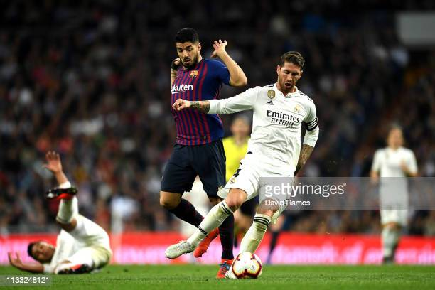 Sergio Ramos of Real Madrid and Luis Suarez of Barcelona clash during the La Liga match between Real Madrid CF and FC Barcelona at Estadio Santiago...