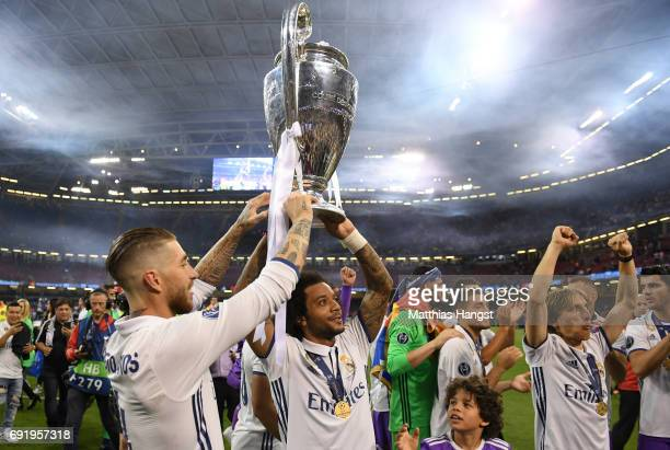 Sergio Ramos of Real Madrid and Marcelo of Real Madrid lift The Champions League trophy after the UEFA Champions League Final between Juventus and...