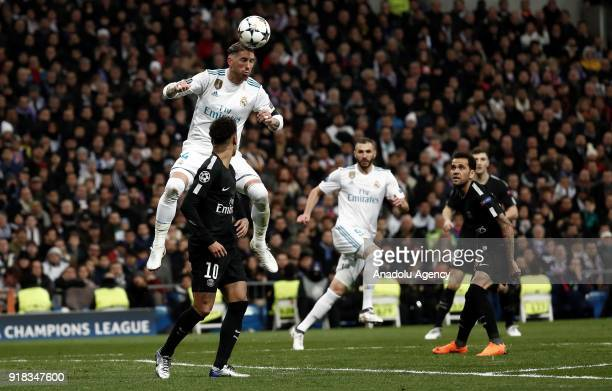 Sergio Ramos of Real Madrid and Neymar Jr of Paris SaintGermain vie for the ball during the UEFA Champions League Round of 16 football match between...