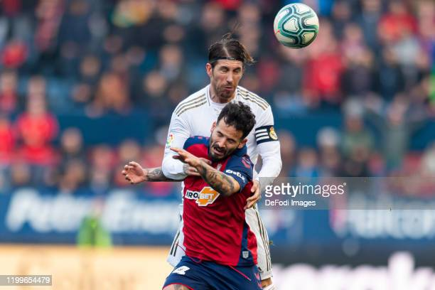 Sergio Ramos of Real Madrid and Ruben Garcia of CA Osasuna battle for the ball during the Liga match between CA Osasuna and Real Madrid CF at El...