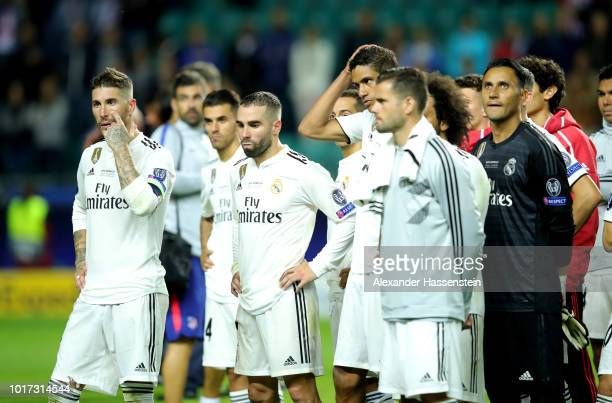 Sergio Ramos of Real Madrid and teammates look dejected following defeat during the UEFA Super Cup between Real Madrid and Atletico Madrid at...