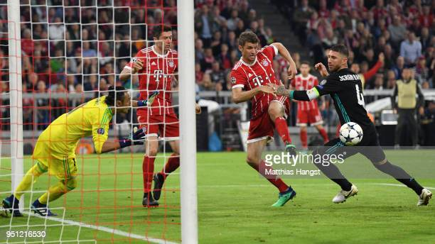 Sergio Ramos of Real Madrid and Thomas Mueller of Bayern Muenchen clash in the area during the UEFA Champions League Semi Final First Leg match...