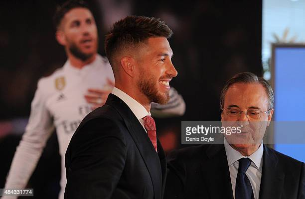 Sergio Ramos of Real Madrid as he stands next to Real president Florentino Perez during a press conference to announce Ramos' new fiveyear contract...