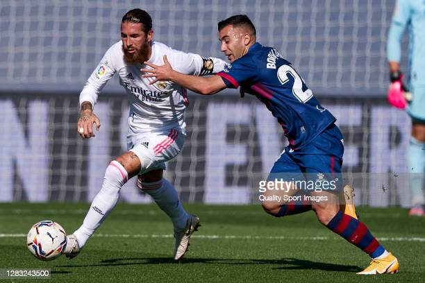 Sergio Ramos of Real Madrid battle for the ball with Borja Garcia of SD Huesca during the La Liga Santander match between Real Madrid and SD Huesca...