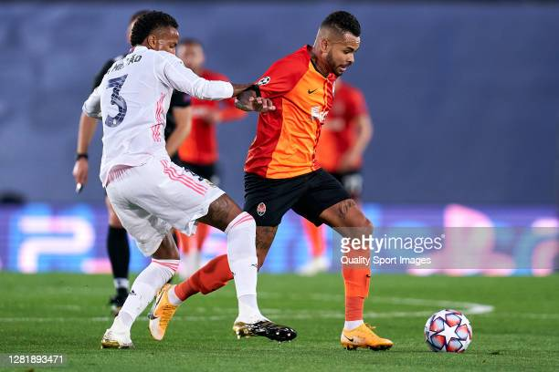 Sergio Ramos of Real Madrid battle for the ball with Dentinho of Shakhtar Donetsk during the UEFA Champions League Group B stage match between Real...