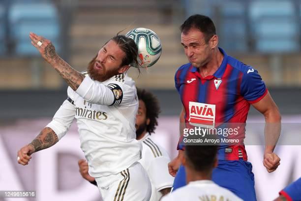 Sergio Ramos of Real Madrid battles for possession with Kike Garcia of Eibar during the Liga match between Real Madrid CF and SD Eibar SAD at Estadio...