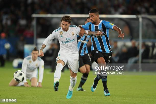 Sergio Ramos of Real Madrid battles with Michel of Gremio FBPA during the FIFA Club World Cup UAE 2017 final match between Gremio and Real Madrid CF...