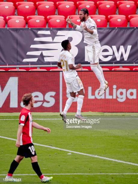 Sergio Ramos of Real Madrid celebrates 01 with Rodrygo of Real Madrid during the La Liga Santander match between Athletic de Bilbao v Real Madrid at...