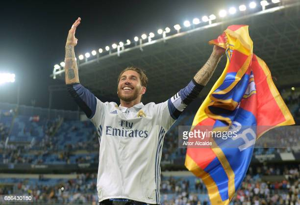 Sergio Ramos of Real Madrid celebrates after his side are crowned champions following the La Liga match between Malaga and Real Madrid at La Rosaleda...
