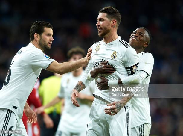 Sergio Ramos of Real Madrid celebrates after scoring his side's second goal with his teammates Vinicius Junior and Nacho Fernandez during the Copa...