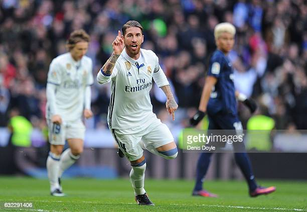 Sergio Ramos of Real Madrid celebrates after scoring his team's 1st goal during the La Liga match between Real Madrid CF and Malaga CF at the...