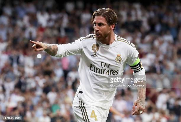 Sergio Ramos of Real Madrid celebrates after scoring his team's first goal during the UEFA Champions League group A match between Real Madrid and...