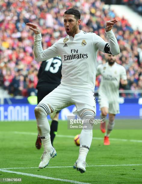 Sergio Ramos of Real Madrid celebrates after scoring his team's second goal from a penalty during the La Liga match between Club Atletico de Madrid...
