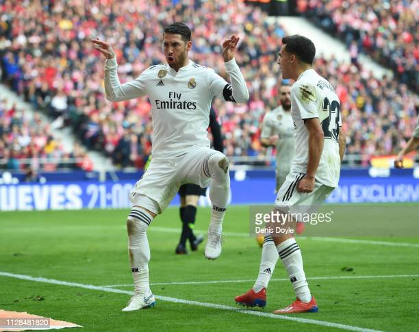 Sergio Ramos of Real Madrid celebrates after scoring his team's second goal from a penalty with Sergio Reguilon during the La Liga match between Club...