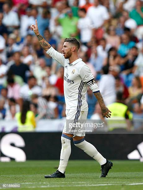Sergio Ramos of Real Madrid celebrates after scoring his team's third goal during the La Liga match between Real Madrid CF and CA Osasuna at Estadio...