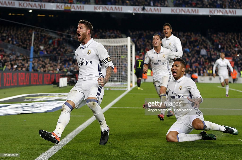 Sergio Ramos (L) of Real Madrid celebrates after scoring the equalising goal during the La Liga match between FC Barcelona and Real Madrid CF at Camp Nou on December 3, 2016 in Barcelona, Spain.