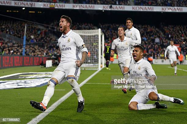 Sergio Ramos of Real Madrid celebrates after scoring the equalising goal during the La Liga match between FC Barcelona and Real Madrid CF at Camp Nou...