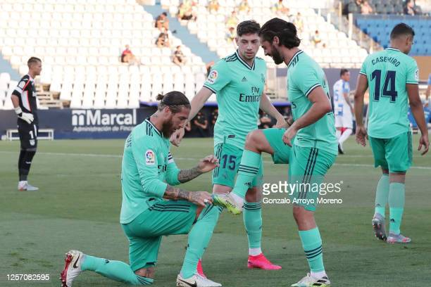 Sergio Ramos of Real Madrid celebrates his team's first goal with teammate Isco during the Liga match between CD Leganes and Real Madrid CF at...