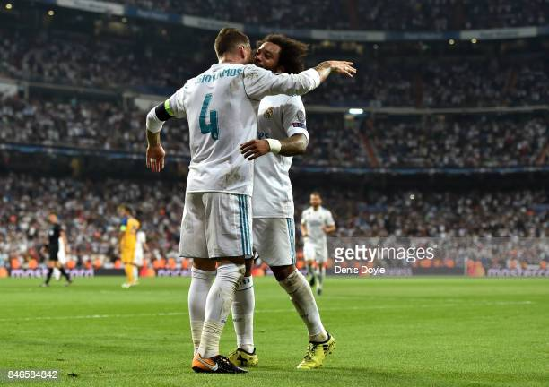 Sergio Ramos of Real Madrid celebrates scoring his sides third goal with Marcelo of Real Madrid during the UEFA Champions League group H match...