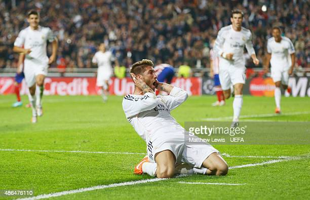 LISBON PORTUGAL MAY 24 Sergio Ramos of Real Madrid celebrates scoring his team's first goal during the UEFA Champions League Final between Real...