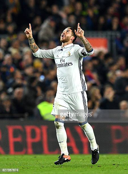Sergio Ramos of Real Madrid celebrates scoring his team's first goal during the La Liga match between FC Barcelona and Real Madrid CF at Camp Nou on...