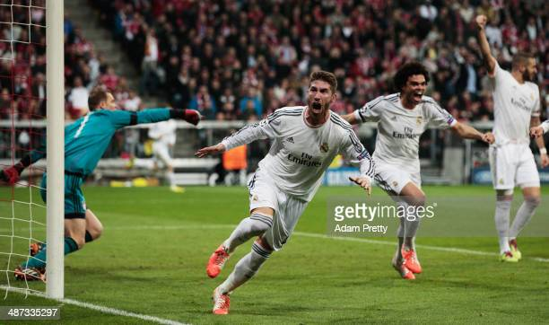Sergio Ramos of Real Madrid celebrates scoring the first goal during the UEFA Champions League semifinal second leg match between FC Bayern Muenchen...