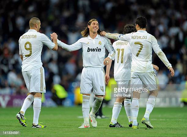 Sergio Ramos of Real Madrid celebrates with Cristiano Ronaldo and Karim Benzema after Real beat PFC CSKA Moskva 41 in the UEFA Champions League Round...