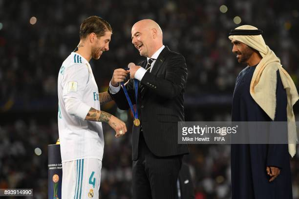 Sergio Ramos of Real Madrid celebrates with Gianni Infantino after the FIFA Club World Cup UAE 2017 Final between Gremio and Real Madrid at the Zayed...