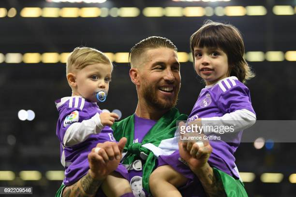 Sergio Ramos of Real Madrid celebrates with his children after victory in the UEFA Champions League Final between Juventus and Real Madrid at...