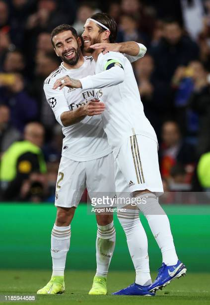 Sergio Ramos of Real Madrid celebrates with his team after he scores his sides third from the penalty spot during the UEFA Champions League group A...