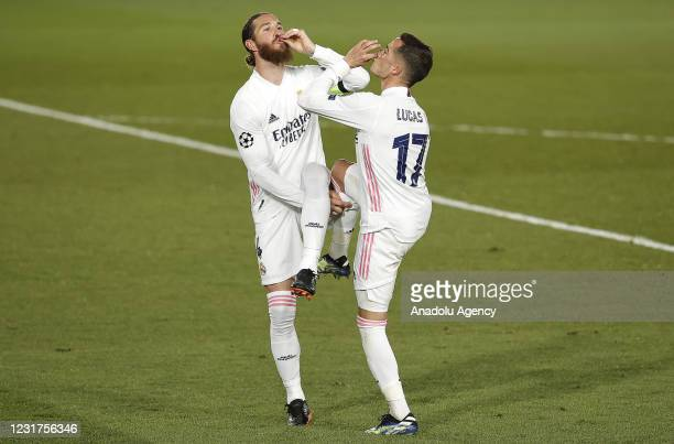 Sergio Ramos of Real Madrid celebrates with his team mate Lucas Vazquez after scoring a goal during the UEFA Champions League Round of 16 match...