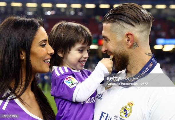 Sergio Ramos of Real Madrid celebrates with his wife and child after the UEFA Champions League Final between Juventus and Real Madrid at National...