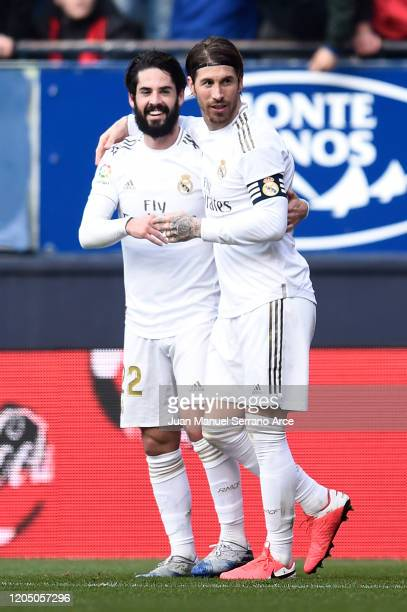 Sergio Ramos of Real Madrid celebrates with Isco after scoring his team's second goal during the La Liga match between CA Osasuna and Real Madrid CF...