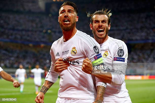 Sergio Ramos of Real Madrid celebrates with team mate Gareth Bale of Real Madrid after scoring the opening goal during the UEFA Champions League...
