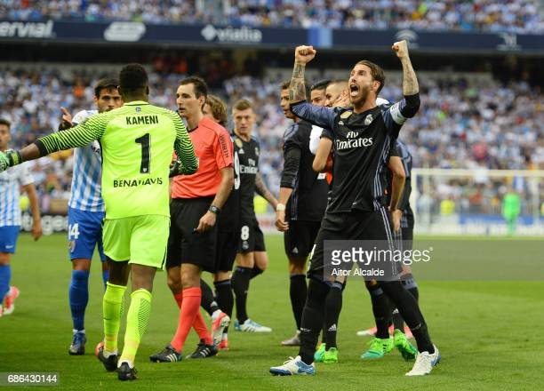 Sergio Ramos of Real Madrid celebrates with team mates after Karim Benzema of Real Madrid scores his sides second goal during the La Liga match...