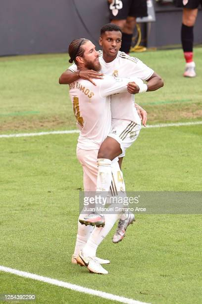 Sergio Ramos of Real Madrid celebrates with teammate Rodrygo after scoring his team's first goal during the La Liga match between Athletic Club and...