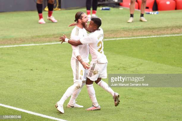 Sergio Ramos of Real Madrid celebrates with teammate Rodrygo of Real Madrid after scoring his team's first goal during the La Liga match between...