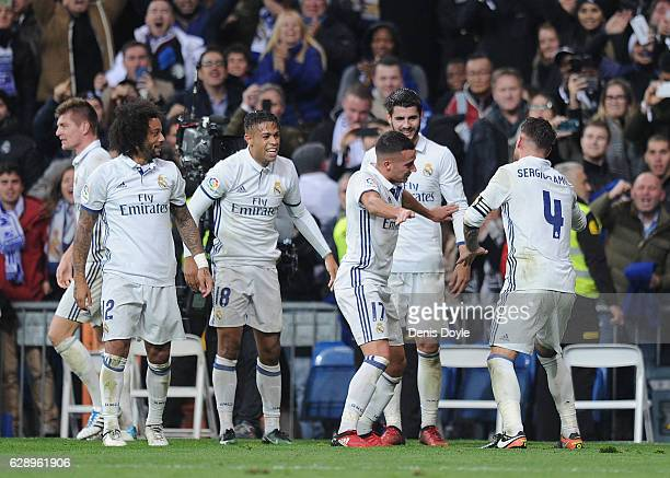 Sergio Ramos of Real Madrid celebrates with teammates after scoring their 3rd goal during the La Liga match between Real Madrid CF and RC Deportivo...