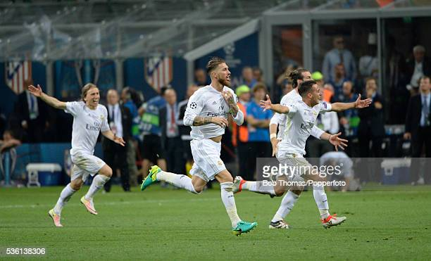 Sergio Ramos of Real Madrid celebrates with teammates after winning the UEFA Champions League Final match between Real Madrid and Club Atletico de...