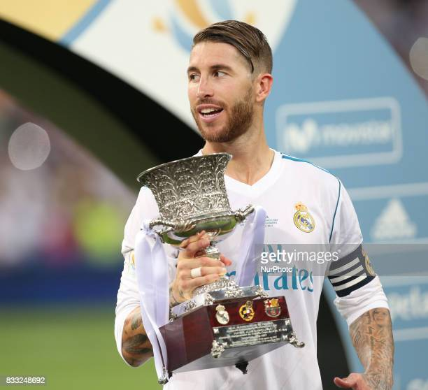 Sergio Ramos of Real Madrid celebrates with the trophy after the Supercopa de Espana Final second leg match between Real Madrid and FC Barcelona at...