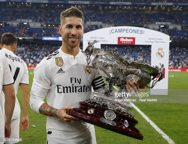 Sergio Ramos of Real Madrid celebrates with the trophy after the Trofeo Santiago Bernabeu match between Real Madrid and AC Milan at Estadio Santiago...