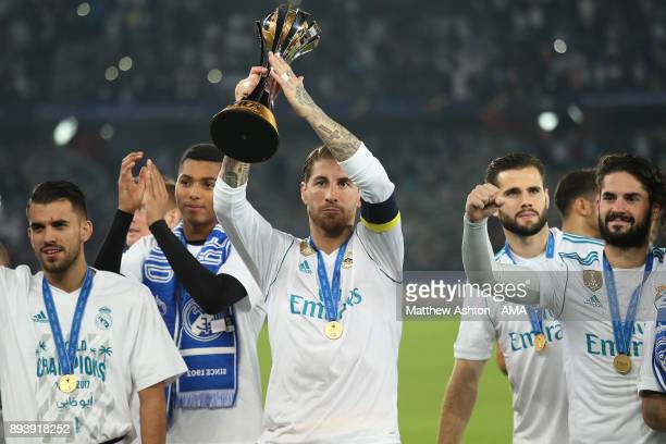 Sergio Ramos of Real Madrid celebrates with the trophy and his teammates at the end of the FIFA Club World Cup UAE 2017 final match between Gremio...