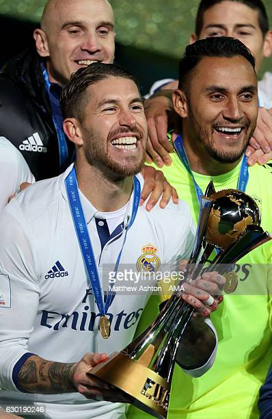 Sergio Ramos of Real Madrid celebrates with the trophy at the end of the FIFA Club World Cup final match between Real Madrid and Kashima Antlers at...